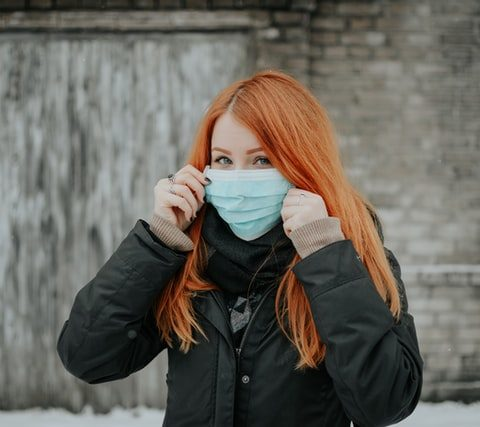 girl with surgical mask ginger hair