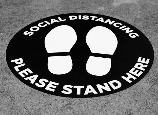 social distance sign on floor