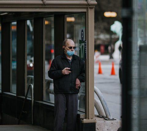 man wearing mask leaving undergrand station