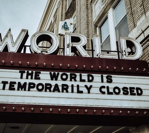 the world is closed signage