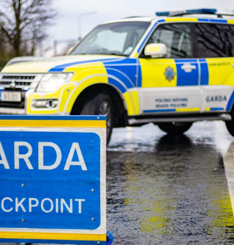 Garda checkpoint with big sign image