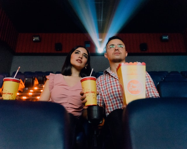 couple in cinema with snack
